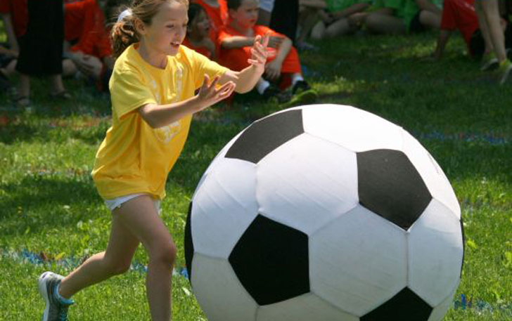 girl-with-giant-soccer-ball