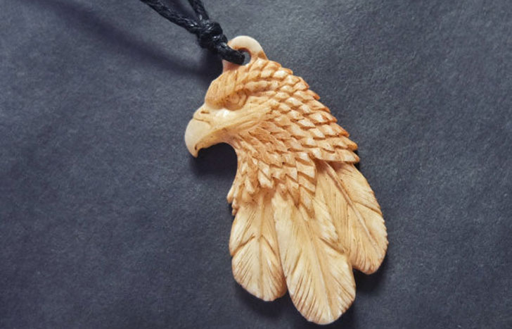 Hand Carved Buffalo Bone Eagle Necklace - meaningful necklaces for guys