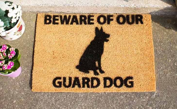 funniest doormats - Beware Of Our Guard