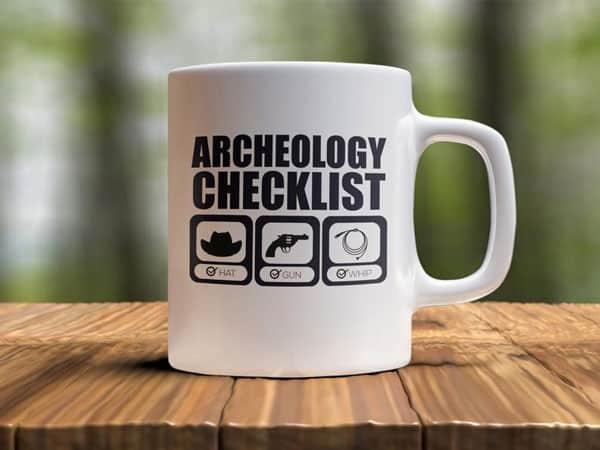 Archeology checklist, hat, gun, whip. Indiana mug
